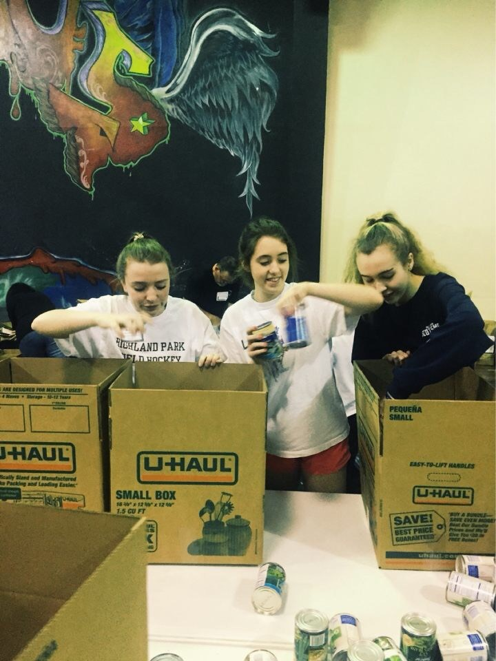 Smile club packing boxes of supplies