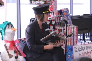 Superintendent Christi Barrett reading the Polar Express to Harmony first graders.