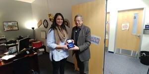 principal caldwell receiving a gift