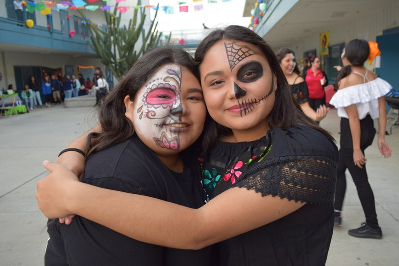BPUSD_ DÍA_1: Juniors Ashlie Chaidez (left) and Angel Luques (right) co-hosted Baldwin Park High School's Día de Los Muertos event on Nov. 3, celebrating the Mexican holiday with traditional Mexican food, music and games.