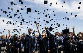 picture of graduates throwing their caps in the air