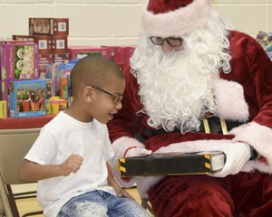 One happy child getting a present from Santa