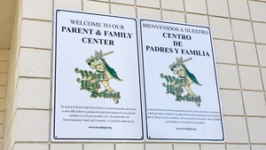 West High School Parent and Family Center signs.