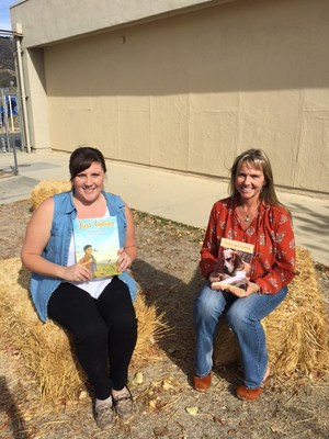 Jackie Neypes and Kris Wood posing with their recently published books.