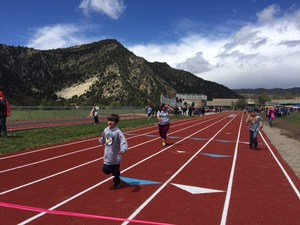Students running on a track.