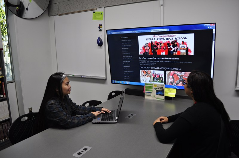 Sierra Vista High School seniors Krishor Carrillo and Lluvia Santiago collaborate on the school yearbook in a study chamber that includes a tech-infused work stations. The school's $175,000 library makeover, which includes five such centers, was unveiled Dec. 8.