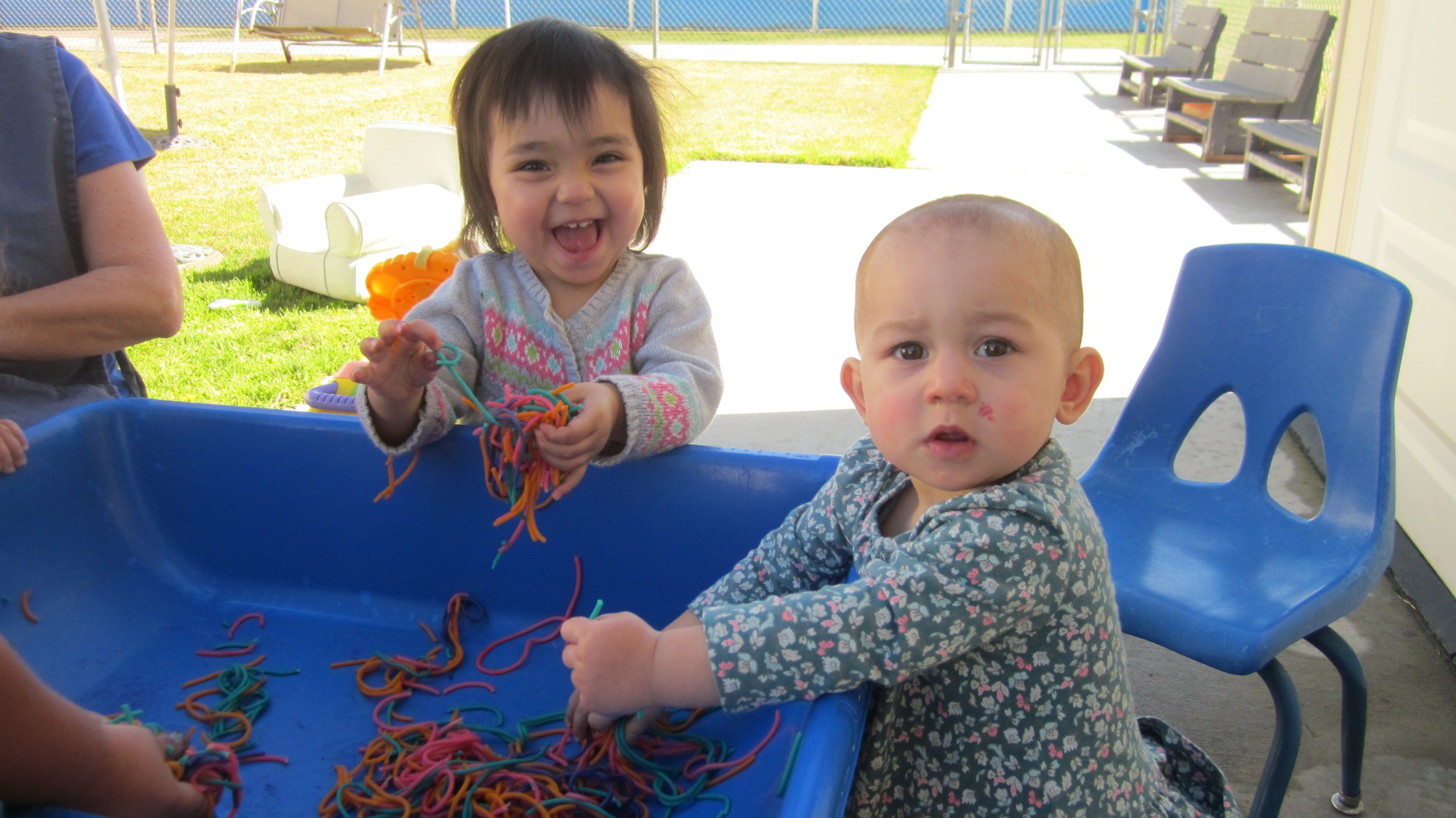 Two babies playing