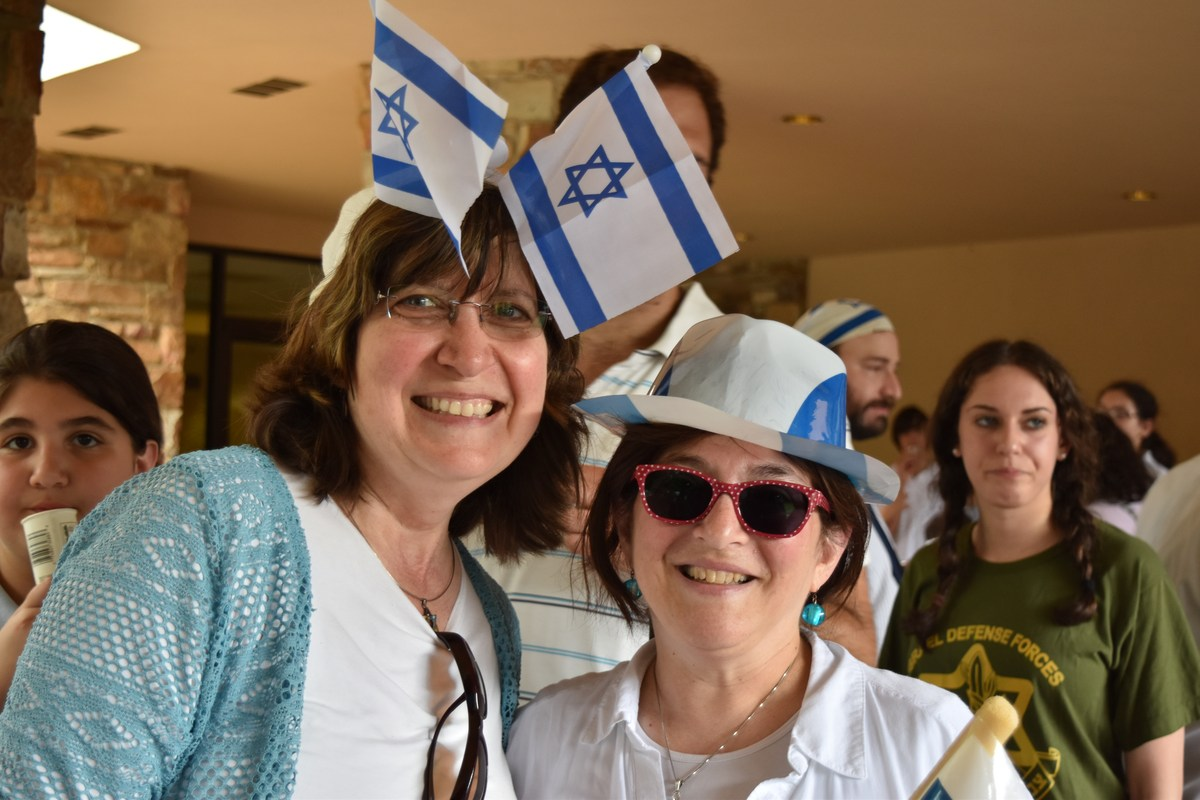 Ladies wearing Israeli flags and hats.