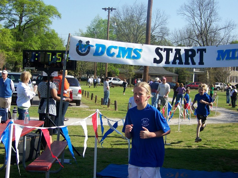 Students running the Delano Mile