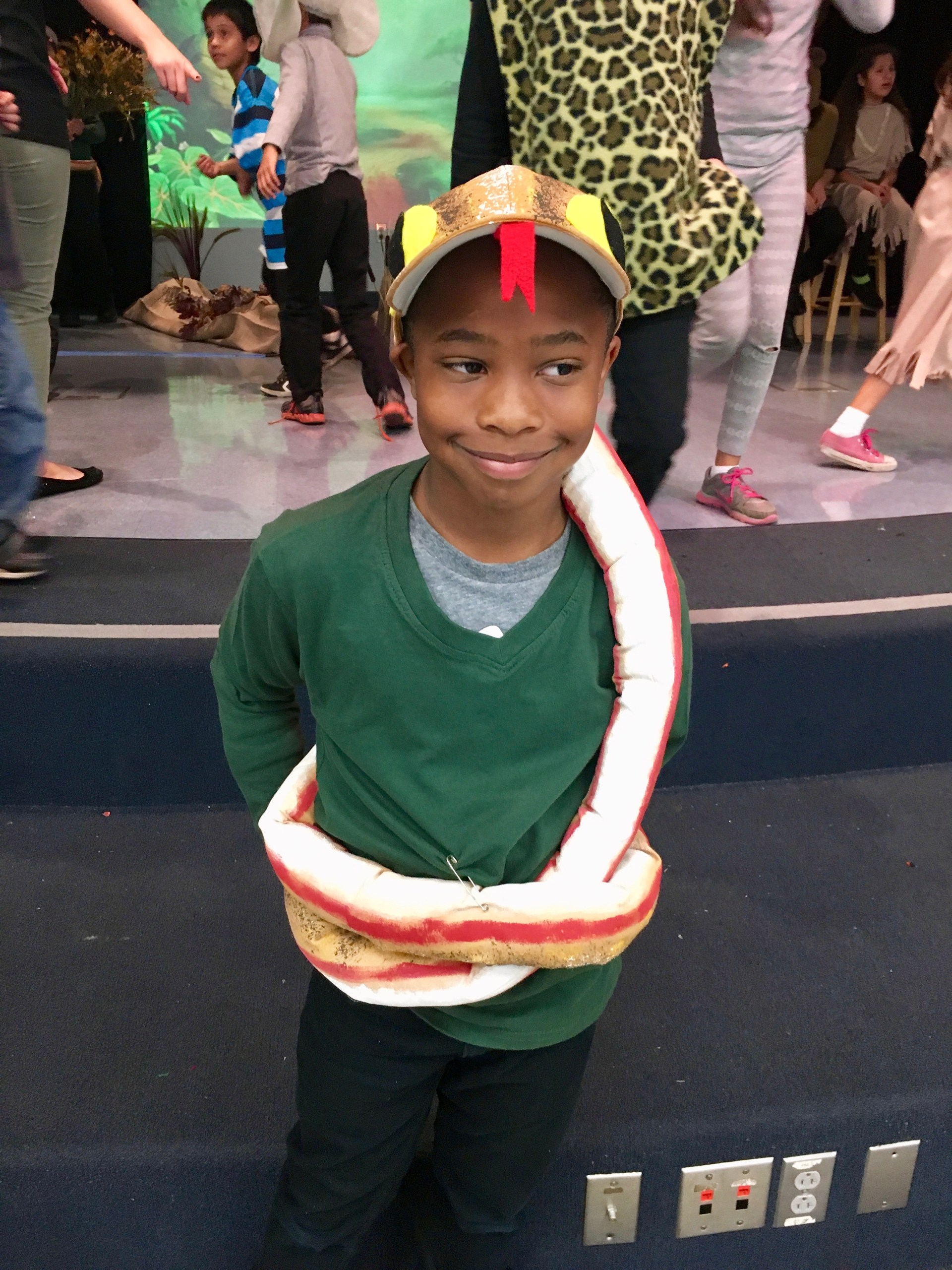 Boy in snake costume for Jungle Book.