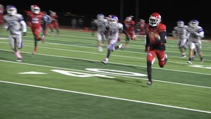 Manor Wide Receiver catches a quick pass and races into the endzone in the first quarter against San Marcos.