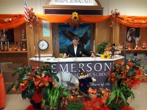 Mirium greeting parents as they enter Emerson