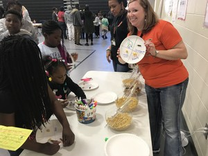 Pinevale Elementary School parent and student enjoy engaging activity during the annual Sci-Tech-eMatics Night