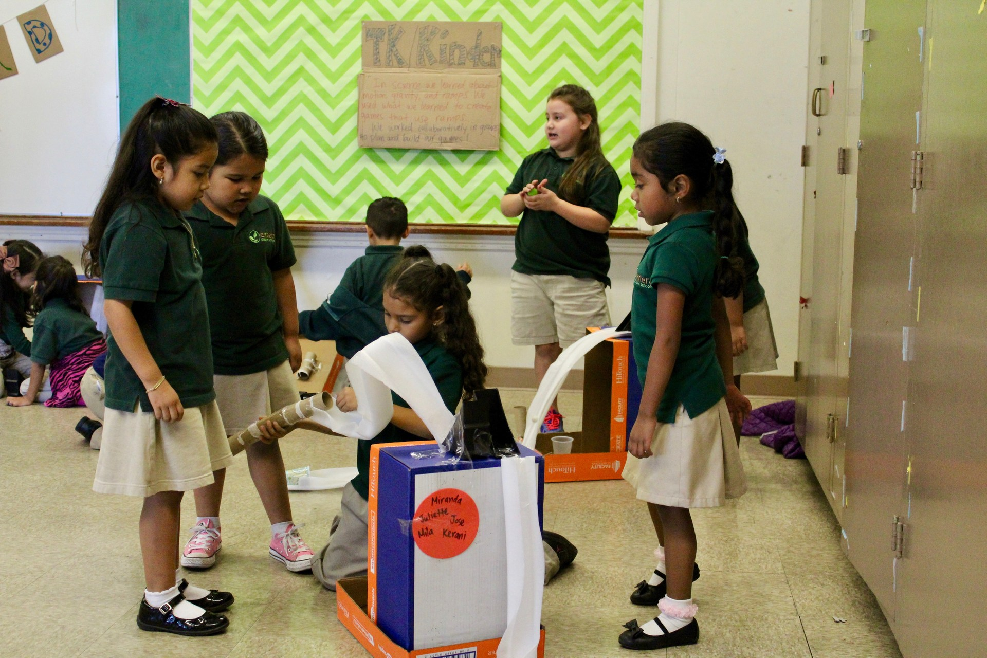 students play with game created by recycled materials