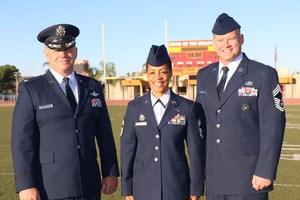 Lt. Col Gevin Harrison, Chief Mst. Sgt. Angela Valentine, and Chief Mst. Sgt. Patrick Wood on the Hemet High School football field.