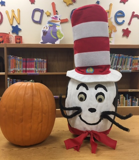 plain pumpkin, pumpkin decorated as cat in the hat.
