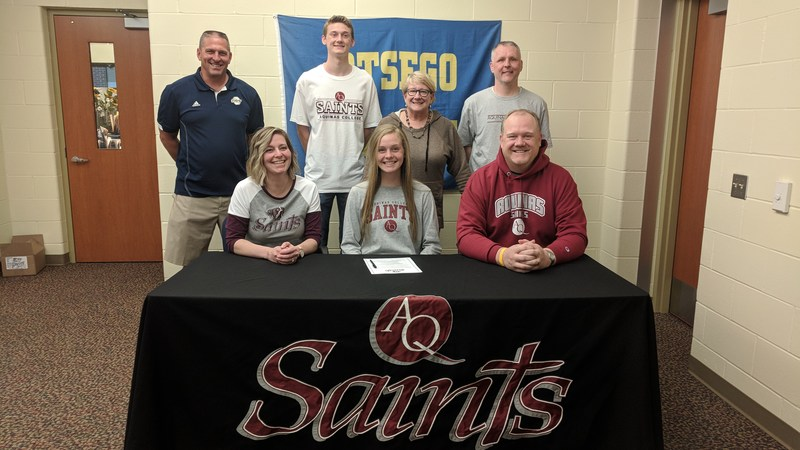Jaycie with her parents, brother, Otsego coach and Aquinas coaches.