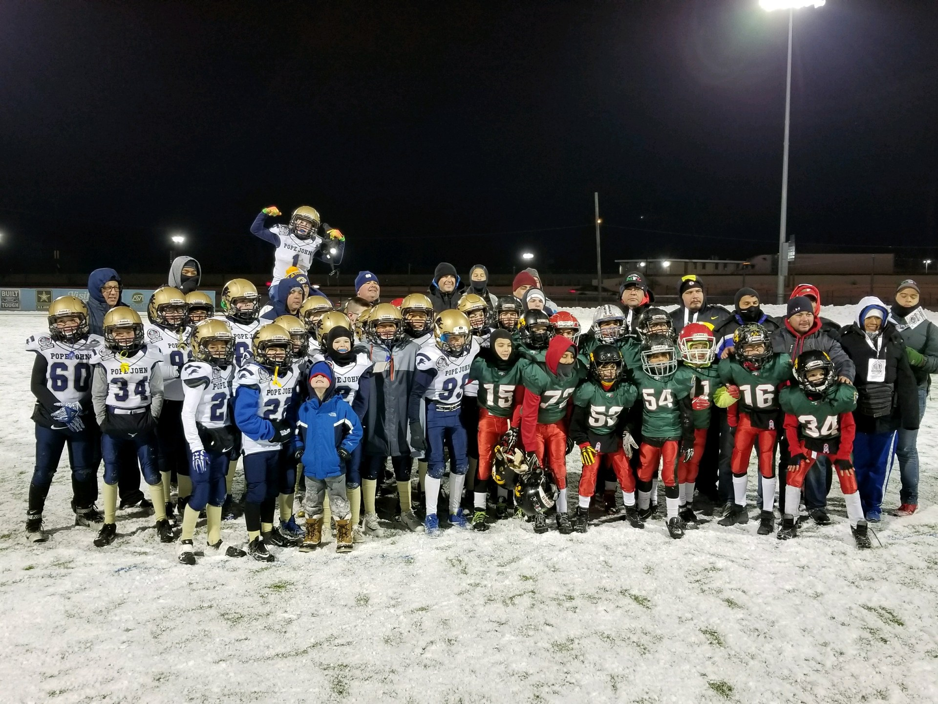 Jr Lions 10U Football team poses after playing team from Mexico at nationals