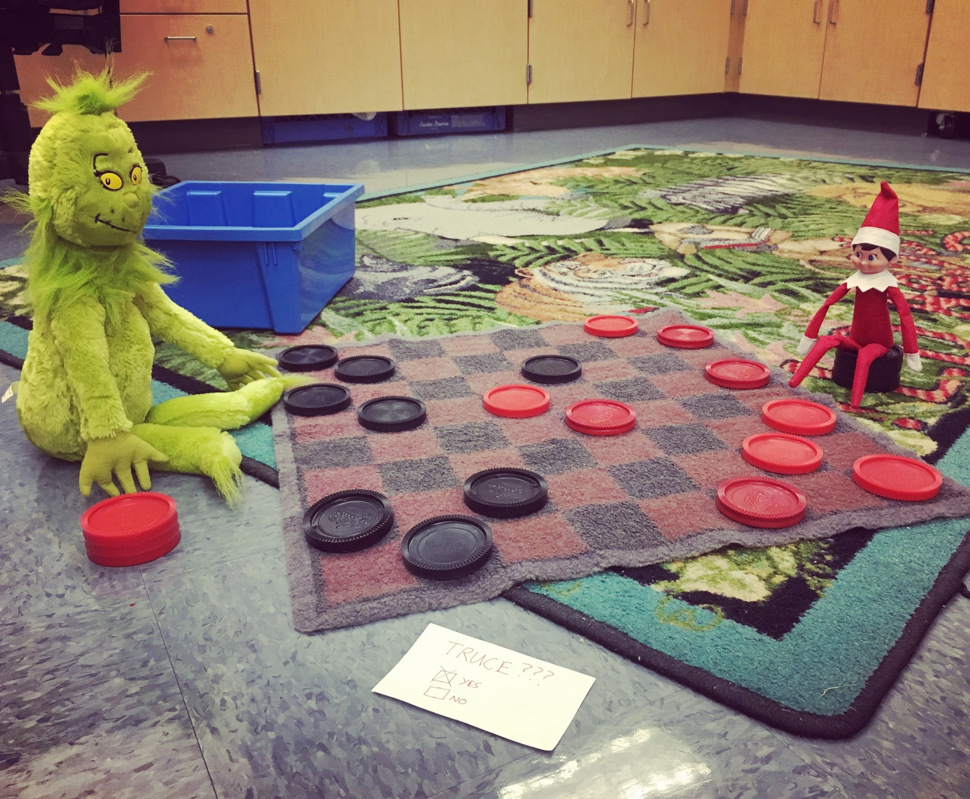 Pippin and the Grinch form a truce over the weekend and decide to play checkers instead of fighting.