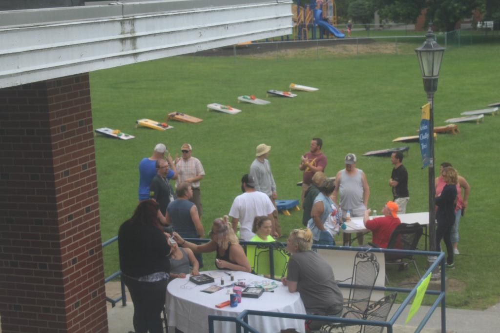 Students and Families playing Cornhole