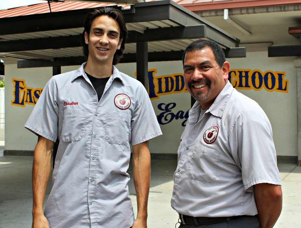 Two staff members smiling for the camera