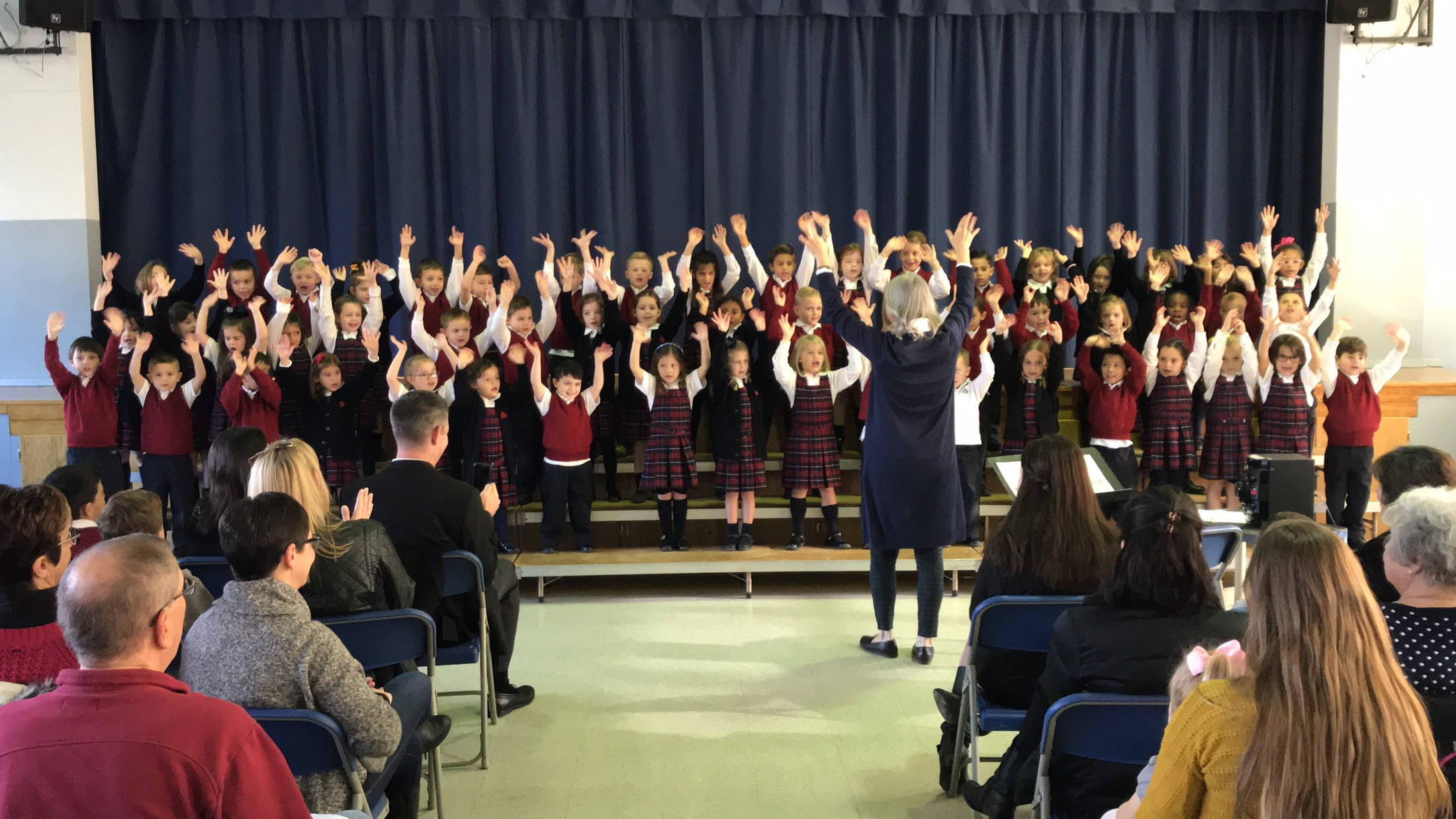 Students sing during a concert