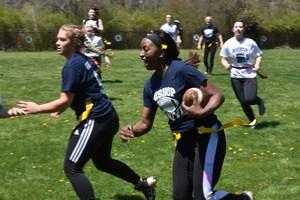 Bri Allen '18 running with football