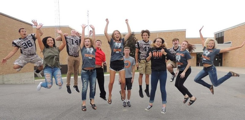 Students jumping in the air.