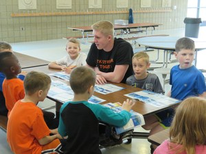 Some high school students visited the elementary schools to work with younger students.
