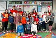 High school mentors pictured with Ness Elementary students.