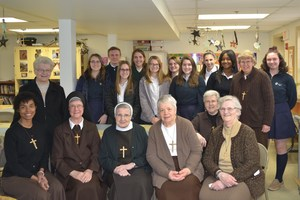 A group of OLSH students pose with Felician Sisters after volunteering together at the Mooncrest After School Program.
