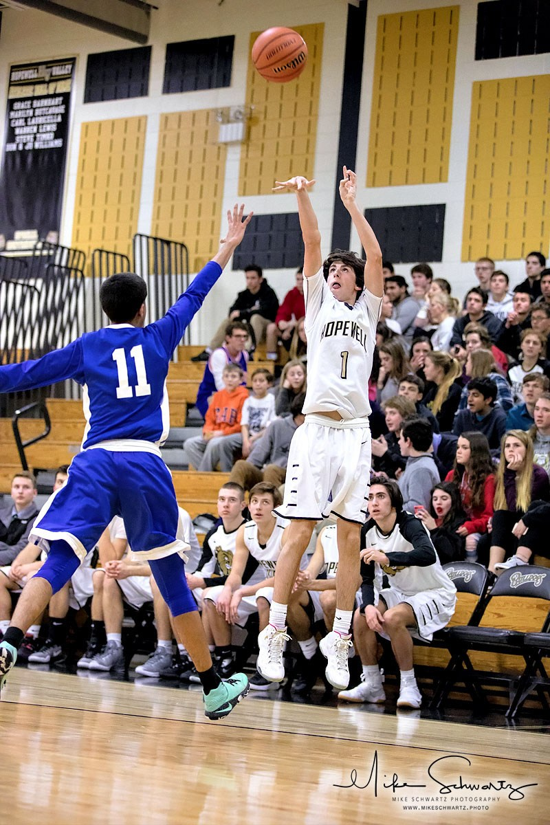 CHS boys basketball player shoots from the corner