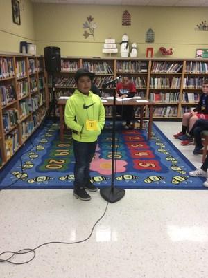 Student at podium.
