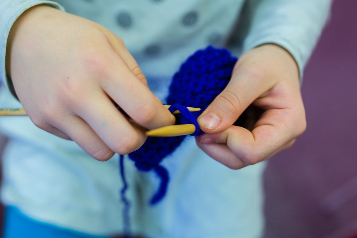 Grade school student knitting