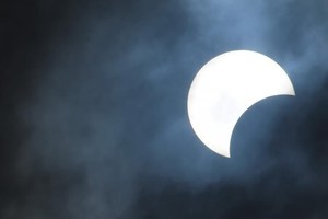 partial-solar-eclipse-cloudy-day.jpg