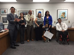 Walnut Elementary Head Start pre-K student Dominic Garcia stands with his winning Red Ribbon Week poster with Baldwin Park Unified Superintendent Froilan N. Mendoza and members of the Board of Education on Nov. 8.