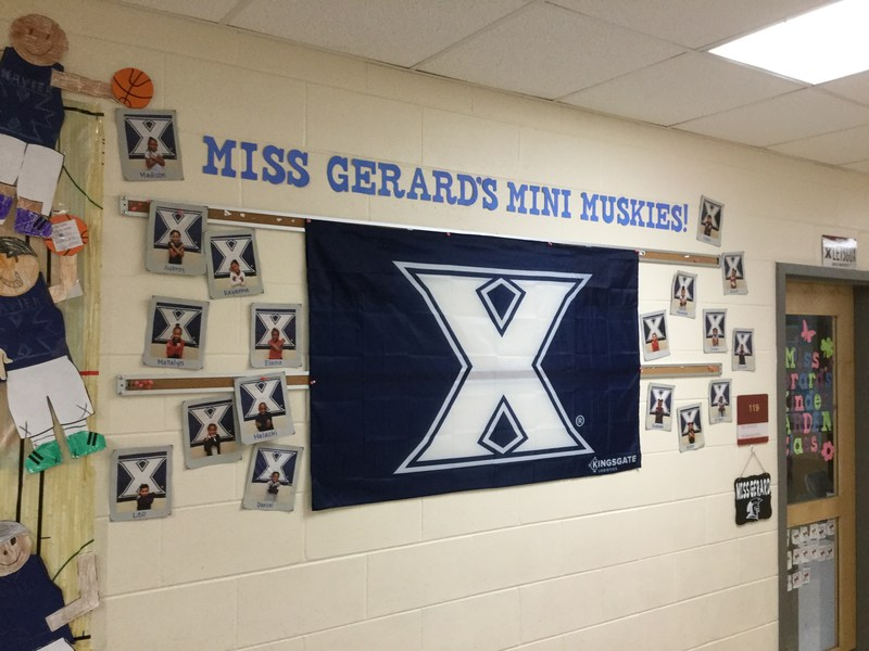 Xavier Musketeer decorations hanging on the walls and ceiling in the Elem. School
