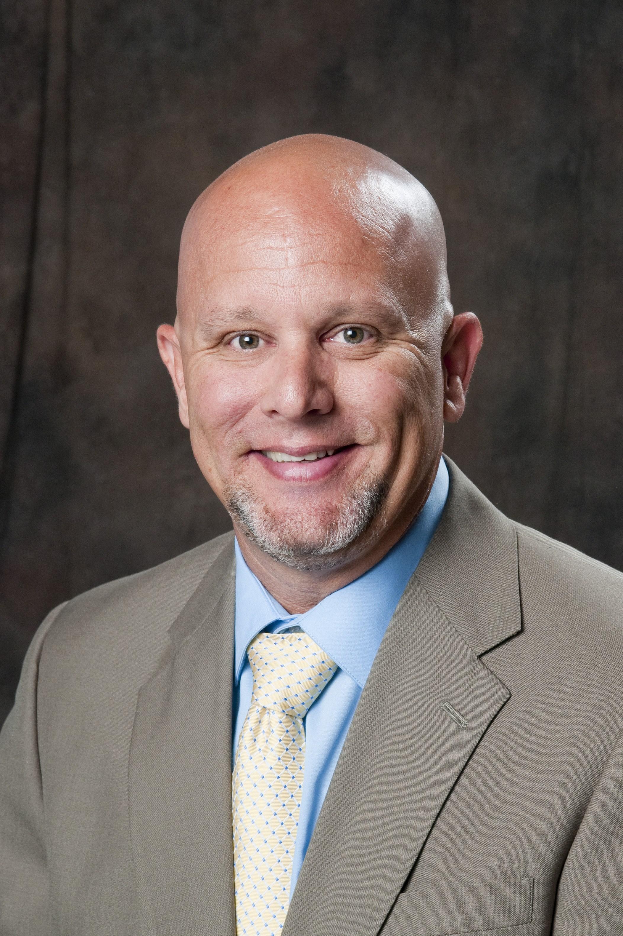 Kevin Daw, Principal of S.L. Mason