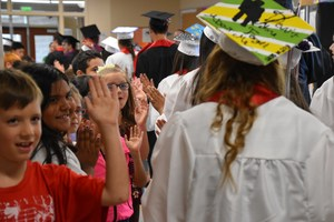 EVHS seniors walking the halls of Terrace Heights Elementary while giving high-fives.