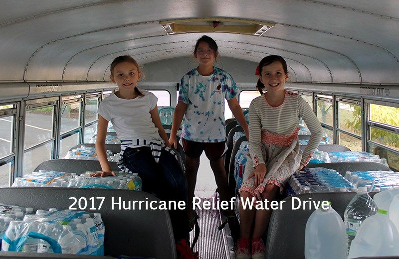 Students help fill the bus during water drive.
