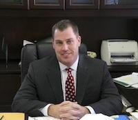 Superintendent Mark Garrett Behind Desk