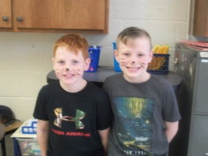 Students dressed as cats for Dr. Seuss' birthday.