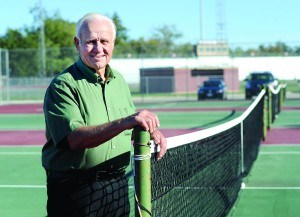 Former CHS tennis coach Charlie Brand photographed at the high school tennis courts named after him