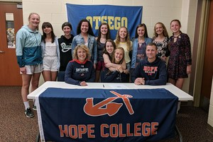Maddie with her parents and teammates
