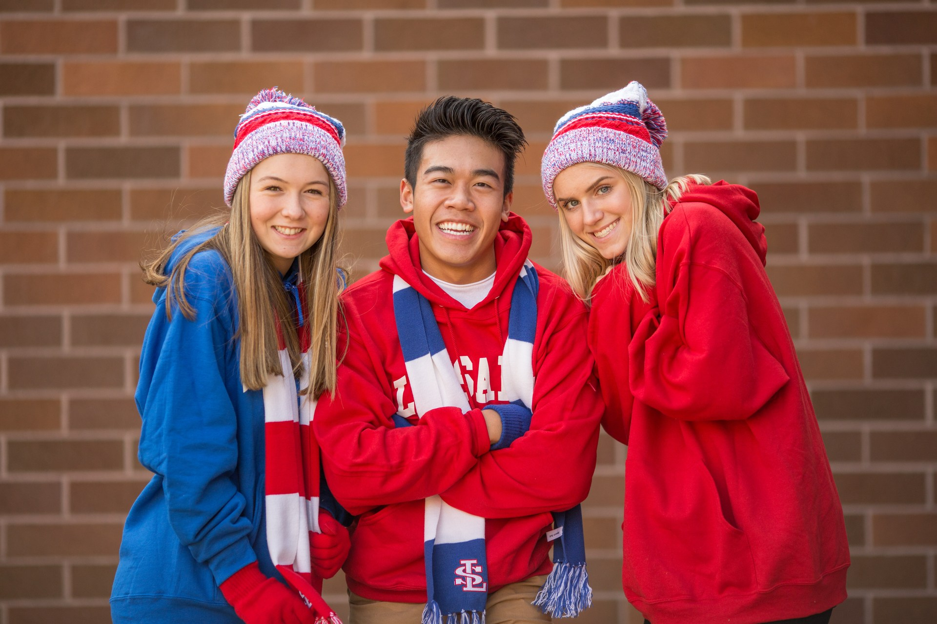 Three smiling students