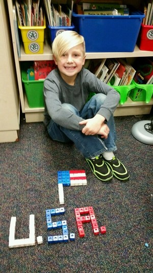 Student makes a Patriotic display with math counting cubes.