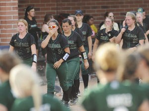 Coloma softball players following quarterfinal loss