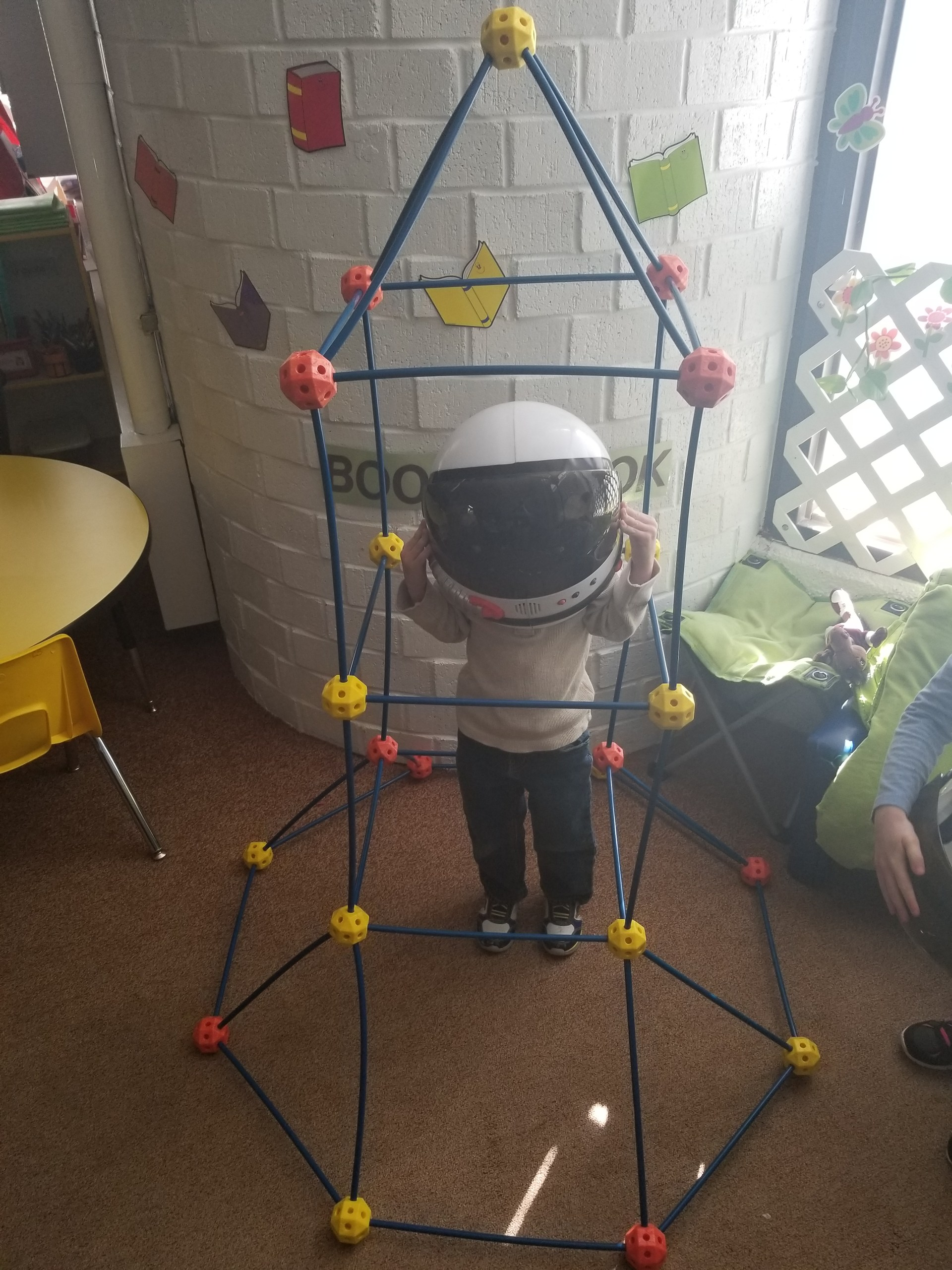 Built a Rocketship and tried on an astronaut helmet.