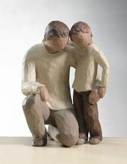 clay sculpture of a father and a son