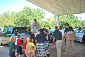 Students Carrying in Donated Food.JPG